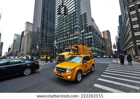 NEW YORK CITY - MARCH 28: Yellow taxi at street,  March 28 2014 in New York, USA - stock photo