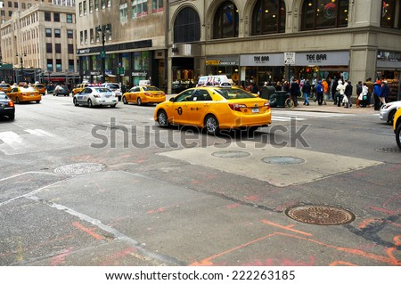NEW YORK CITY - MARCH 27: Yellow taxi at street,  March 27 2014 in New York, USA - stock photo