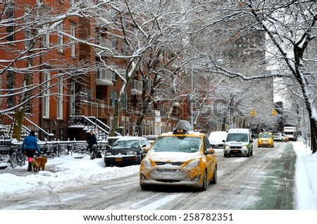 New York City - March 5, 2015: Yellow taxi in Manhattan in the winter, New York City, USA. - stock photo