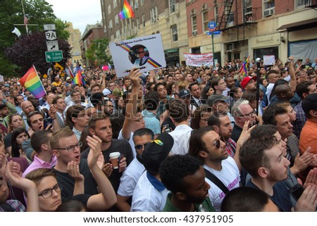 NEW YORK CITY - MAY 13 2016:  Andrew Cuomo & Bill de Blasio appeared together before the Stonewall Inn for a vigil for the victims of the Orlando massacre. Applause for speakers at vigil