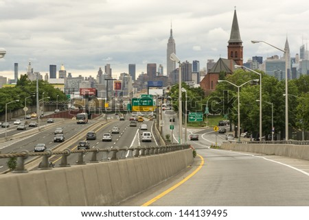 NEW YORK CITY - MAY 22: Cars arrive in the city, May 22, 2013 in New York City. Traffic is a growing issue in the Big Apple. - stock photo