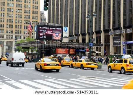 NEW YORK CITY - MAY 6, 2013: Entrance of Madison Square Garden and Yellow Cabs on Seventh Avenue, Manhattan, New York City, USA.