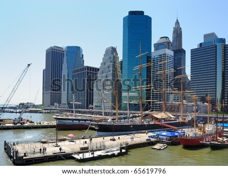 NEW YORK CITY - MAY 20: Historic schooners sit docked under skyscrapers as a tourist attraction on the coast of Manhattan May 20, 2010 in New York, NY. - stock photo