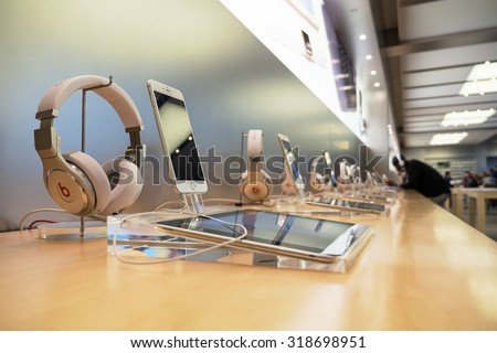 NEW YORK CITY - MAY 13, 2015: Ipad, Iphone and earphones dispayed inside Apple store. As of 2014, Apple employs 72,800 permanent full-time employees, maintains 437 retail stores in fifteen countries.  - stock photo