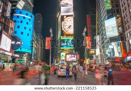 NEW YORK CITY - MAY 25, 2013: Lights of Times Square at night. Featured with Broadway Theaters and animated LED signs, is a symbol of New York City and the United States.