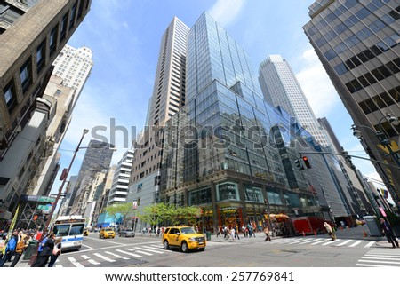 NEW YORK CITY - MAY 7: Manhattan Intersection and Skyscrapers wide angle at Fifth Avenue on 46th Street (Little Brazil Street), Midtown Manhattan on May 7th, 2013 in New York City, USA - stock photo