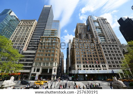 NEW YORK CITY - MAY 7: Manhattan Skyscrapers wide angle in front of New York Public Library at Fifth Avenue and Library Way (41th Street), Midtown Manhattan on May 7th, 2013 in New York City, USA - stock photo