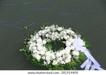 NEW YORK CITY - 25 MAY 2015: Mayor Bill de Blasio & Gen John Kelly presided over Memorial Day observances on Pier 86 by the USS Intrepid. Wreath in the Hudson River along Pier 86 - stock photo