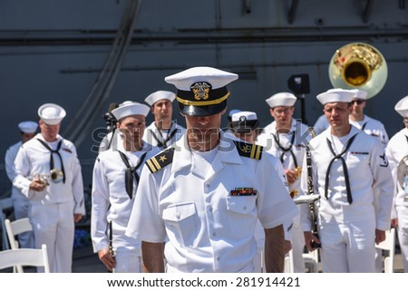 NEW YORK CITY - 25 MAY 2015: Mayor Bill de Blasio & Gen John Kelly presided over Memorial Day observances on Pier 86 by the USS Intrepid. Moment of silence with US navy band - stock photo