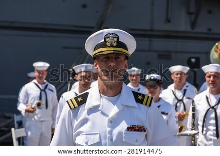 NEW YORK CITY - 25 MAY 2015: Mayor Bill de Blasio & Gen John Kelly presided over Memorial Day observances on Pier 86 by the USS Intrepid. US Navy band at attention - stock photo