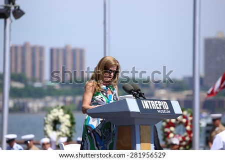 NEW YORK CITY - 25 MAY 2015: Mayor Bill de Blasio & Gen John Kelly presided over Memorial Day observances on Pier 86 by the USS Intrepid. Museum president Susan Marenoff-Zausner speaks on pier 86 - stock photo