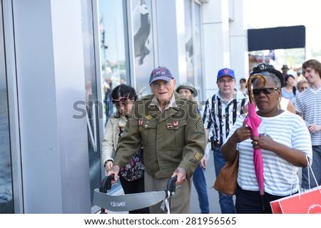 NEW YORK CITY - 25 MAY 2015: Mayor Bill de Blasio & Gen John Kelly presided over Memorial Day observances on Pier 86 by the USS Intrepid. World War Two veteran on pier 86 - stock photo