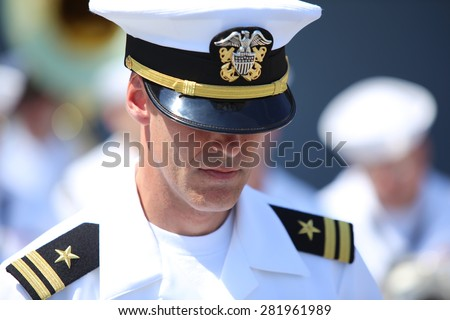 NEW YORK CITY - MAY 25 2015: Mayor de Blasio & General John Kelly led Memorial Day commemorations on Pier 86 by the USS Intrepid. Moment of silence for US Navy band - stock photo