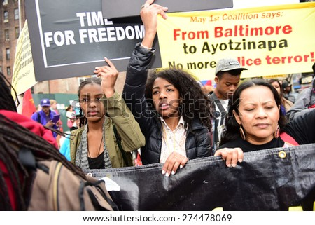 NEW YORK CITY - MAY 1 2015: more than one thousand marched from Union Square Park to Foley Square in celebration of International Workers' Day & continue to demand accountability for law enforcement - stock photo