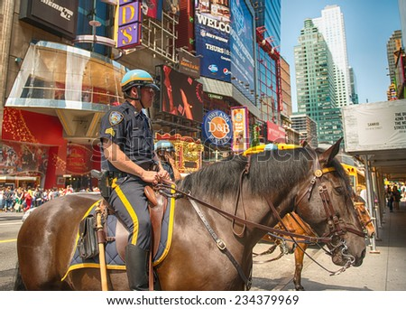 NEW YORK CITY - MAY 27: New York Police officers on horseback as part of the highly visible security on Times Square, May 27, 2013 in Manhattan, New York City - stock photo