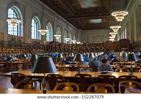 NEW YORK CITY - MAY 5: New York Public Library, the third largest public library in North America. Detail of desks and lamps on the Rose main reading room. May 5th, 2013 in Manhattan, New York City. - stock photo