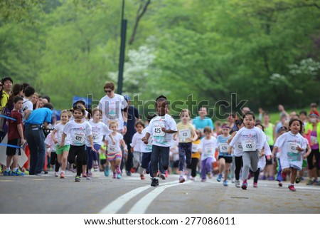 NEW YORK CITY - MAY 10 2015: New York Road Runners sponsored a Kids' Run in Central Park to mark the 9th annual Japan Day. Kids 2 - 12 participated in groups staggered by age & sex - stock photo