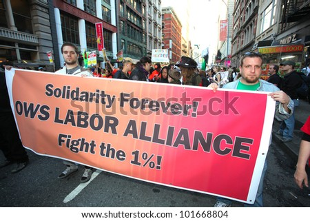 NEW YORK CITY - MAY 1 : Occupy Wall Street is joined by labor unions expressing their solidarity by marching down Broadway in honor of International Workers' Day  on May 1 2012 in New York City