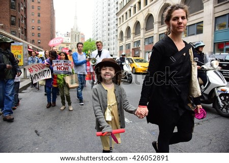NEW YORK CITY - MAY 21 2016: One hundred activists led by Reverend Billy Talen marched along Broadway into Lower Manhattan to protest Monsanto corporation's release of toxins into the environment