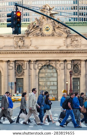 NEW YORK CITY - MAY 14, 2015: People crossing street in front of Grand Central Station. - stock photo