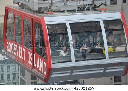 NEW YORK CITY - MAY 3: Roosevelt Island cable tram car that connects Roosevelt Island to Manhattan in New York, as seen on May 3, 2014. - stock photo