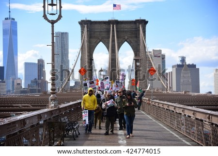 NEW YORK CITY - MAY 15 2016: Several hundred activists marked Al Nakbah, the expulsion of the Palestinians & formation of Israel, with a rally & march across the Brooklyn Bridge.