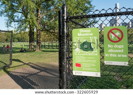 NEW YORK CITY - MAY 7, 2015: Sheep Meadow sign in Central Park. The park is the most visited urban park in the United States with 35 million visitors annually.