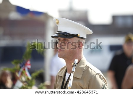 NEW YORK CITY - MAY 25 2016: Ships of the US Navy docked in the Brooklyn Ferry Terminal as the 28th annual Fleet Week started. US Marine Corps band leader