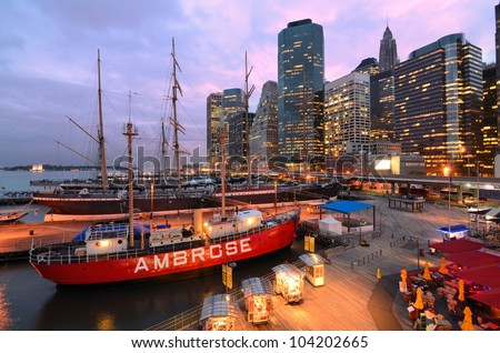 NEW YORK CITY - MAY 22: South Street Seaport May 22, 2012 in New York, NY. The port is a designated historic district containing the largest concentration of 19th century landmarks in the city. - stock photo