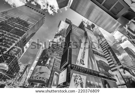 NEW YORK CITY - MAY 19: Tall skyscrapers and ads of Times Square, May 19, 2013 in New York. Times Square is the most visited tourist attraction in the world with over 39 million visitors annually - stock photo