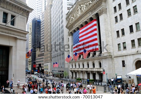 NEW YORK CITY - MAY 27: The historic New York Stock Exchange on Wall Street with crowds below, one of the largest stock exchanges in the world May 27, 2010 in New York, New York. - stock photo