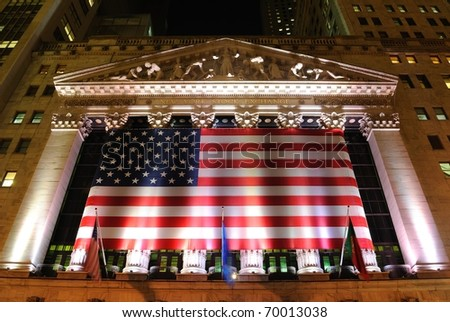 NEW YORK CITY - MAY 26: The historic New York Stock Exchange, one of the largest stock exchanges in the world, illuminated at night May 26, 2010 in New York, New York. - stock photo