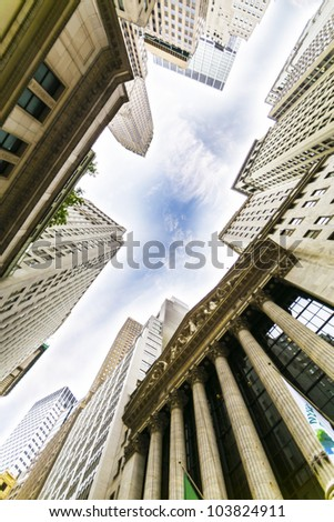 NEW YORK CITY - MAY 15: The New York Stock Exchange and surrounding buildings in the Financial District on May 15, 2012. - stock photo