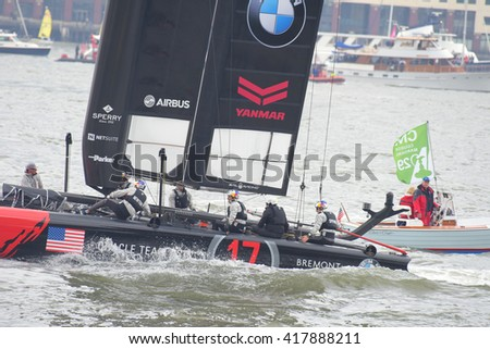 NEW YORK CITY - MAY 7 2016: the 35th annual America's Cup yacht race was held in New York harbor as six contenders vied in uneven weather. Team Oracle, US working boat