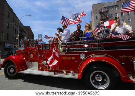 NEW YORK CITY - MAY 26 2014: The 146th annual King's County Memorial Day Parade, one of the nation's oldest, honored fallen & living veterans in the streets of Bay Ridge, Brooklyn. Vintage fire engine - stock photo