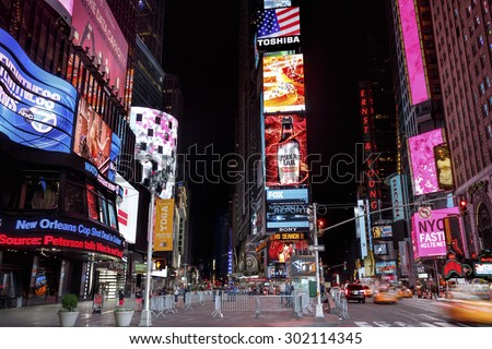 NEW YORK CITY - MAY 25: Times Square, featured with Broadway Theaters and animated LED signs, is a symbol of New York City and the United States, May 25, 2015 in Manhattan, New York City.