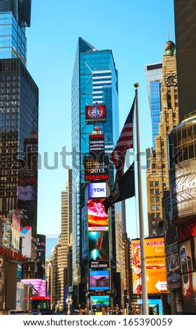 "NEW YORK CITY - MAY 12: Times Square on May 12, 2013 in New York City. Iconified as ""The Crossroads of the World"" it's the brightly illuminated hub of the Broadway Theater District."