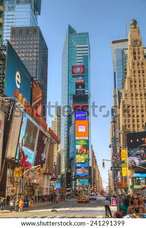 NEW YORK CITY - MAY 12: Times Square on May 12, 2013 in New York City. It's the brightly illuminated hub of the Broadway Theater District, one of the world's busiest pedestrian intersections.
