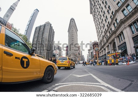 NEW YORK CITY - MAY 9, 2015: Traffic in Downtown Manhattan at intersection. In front of Eataly store and Flatiron building.