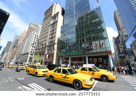 NEW YORK CITY - MAY 7: Yellow Cabs on Fifth Avenue, Manhattan on May 7th, 2013 in New York City, USA - stock photo