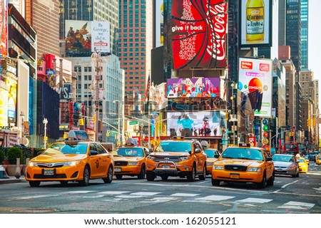 NEW YORK CITY - MAY 12: Yellow taxis at Times Square with the tourists on May 12, 2013 in New York. Yellow cars serve as taxis in NYC and are easy to spot among other vehicles because of their color.