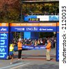 New York City Mayor Michael Bloomberg holds the finish line tape as Marilson Gomes dos Santos of Brazil finishes first in the 2006 ING New York City Marathon - stock photo