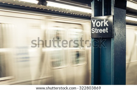 New york city metro station in York street. Metro commuter running fast in the background - stock photo