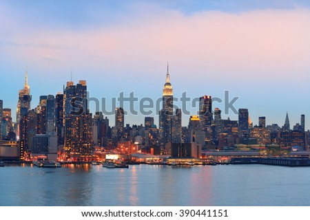 New York City midtown Manhattan in the evening with skyline panorama view over Hudson River - stock photo