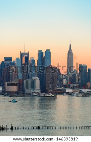 New York City midtown Manhattan sunset skyline panorama view over Hudson River - stock photo