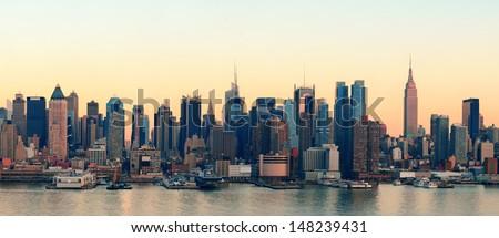 New York City midtown Manhattan sunset skyline panorama view over Hudson River - stock photo