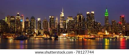 New York City midtown skyline panorama at night over Hudson river, USA - stock photo