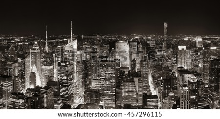 New York City midtown skyline panorama with skyscrapers and urban cityscape at night. - stock photo