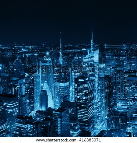 New York City midtown skyline with skyscrapers and urban cityscape at night. - stock photo