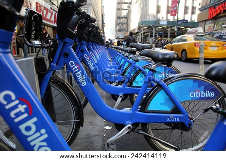 NEW YORK CITY - MONDAY, DEC. 29, 2014: A Citi Bike station in midtown Manhattan. Citi Bike is a privately owned public bicycle sharing system that serves parts of New York City.  - stock photo